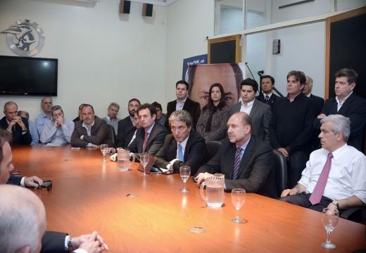 Diego Mansilla junto a Perotti, Julián Domínguez, José Scioli, Caló, Peirano y Urtubey.